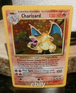 1999 Pokemon Charizard 4/102 Base Set Unlimited Holo Rare NM Very Good